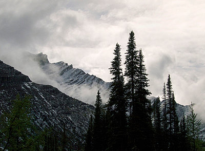 clouds over rugged mountains, Canadian Rocky Mountain Range, Canada - p6942387 by Mark Katzman