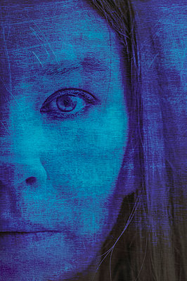 Close-up portrait of womans face with scratched blue overlay - p1047m2092607 by Sally Mundy
