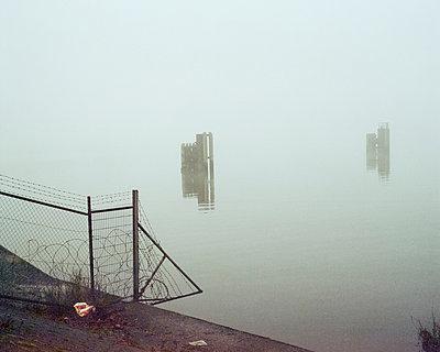 Mooring poles - p1214m1028170 by Janusz Beck