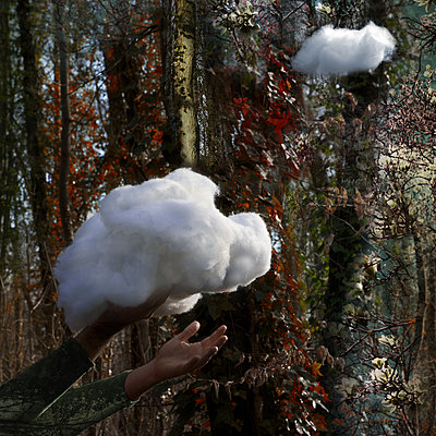 Cloud from cotton wool in hands - p1240m2063329 by Adeline Spengler