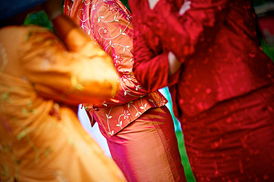 Colourful clothes on a wedding - p6650069 by Roman Thomas