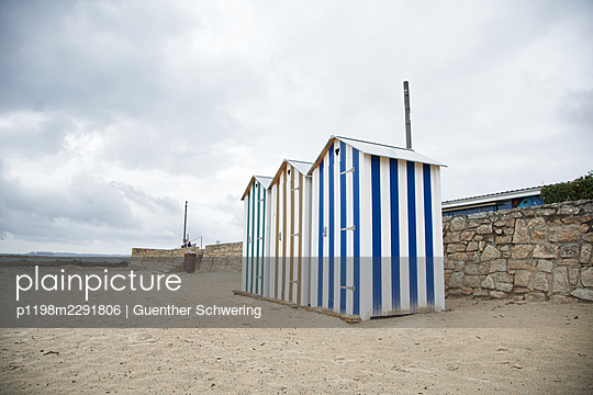 Three beach huts - p1198m2291806 by Guenther Schwering