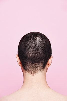 woman with short hair from back on pink background - p1540m2211020 by Marie Tercafs