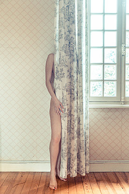 Naked body behind a curtain - p1619m2192726 by Laurent MOULAGER