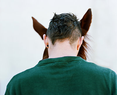Young man with horse  - p453m2157636 by Mylène Blanc