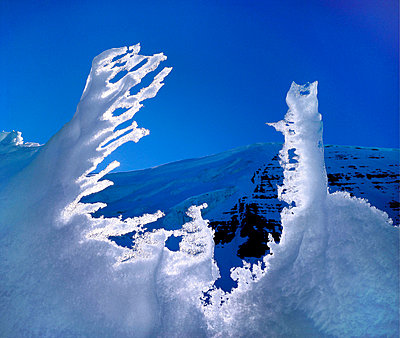 Melting Snow in Front of a Mountain - p871m861971f by Geoff Renner