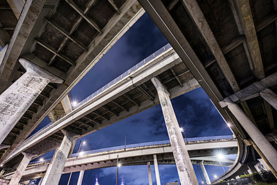 Low angle view of multiple lane highway against sky - p1166m1489339 by Cavan Images