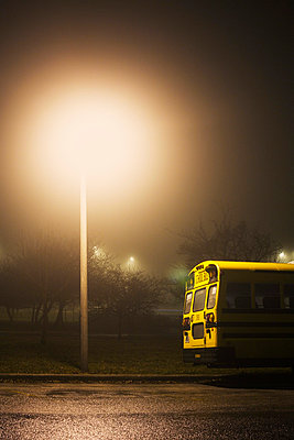 Schoolbus at night, illuminated - p3720432 by James Godman