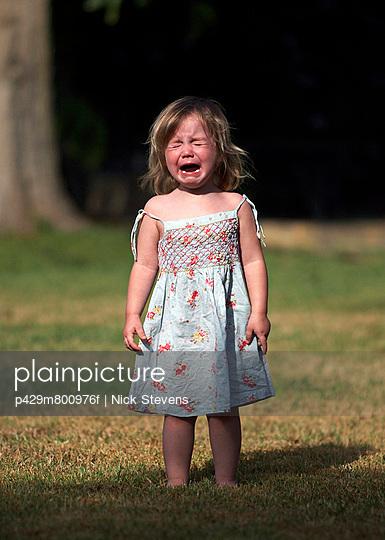 Girl crying in backyard