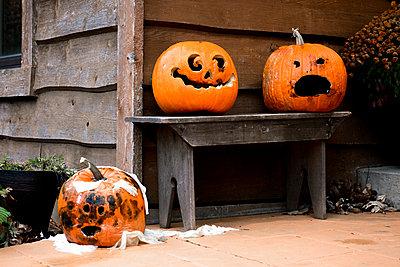 Jack O' Lanterns on porch during Halloween - p1166m1545816 by Cavan Social