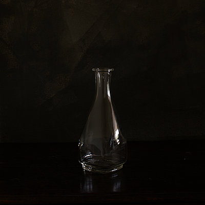 bottle in dark space - p1470m1539157 by julie davenport