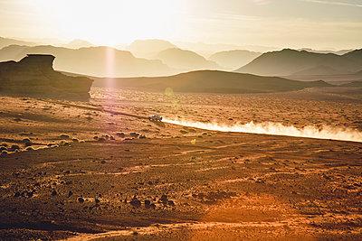 Jordan, Sand dust from a 4-wheeler in Wadi Rum desert - p300m980468f by Florian Löbermann