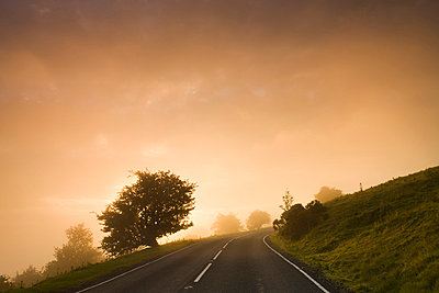 Misty conditions at sunrise on a moorland road, Brecon Beacons National Park, Powys, Wales, United Kingdom, Europe - p8713061 by Adam Burton