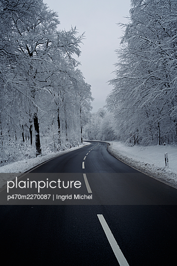 Road through the snowy Taunus  - p470m2270087 by Ingrid Michel