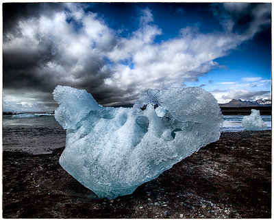 Ice blocks on shore - p1154m1110133 by Tom Hogan