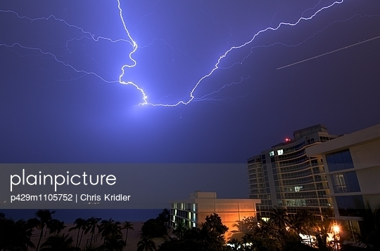 Lightning sparks over the hotels and Atlantic Ocean at Fort Lauderdale, Florida, USA - p429m1105752 by Chris Kridler