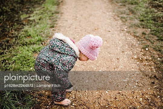 Little girl on a path in the woods - p1628m2244873 by Lorraine Fitch