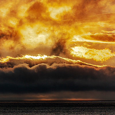 Sunset, dramatic sky over the sea - p280m2172307 by victor s. brigola