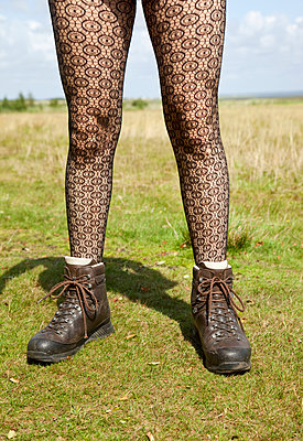 Fishnet stockings and hiking boots - p382m1091326 by Anna Matzen