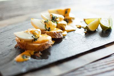 Appetizers arranged on plate - p623m1495174 by Gabriel Sanchez