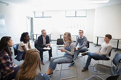 Girl middle school student speaking in debate club classroom - p1192m1473294 by Hero Images
