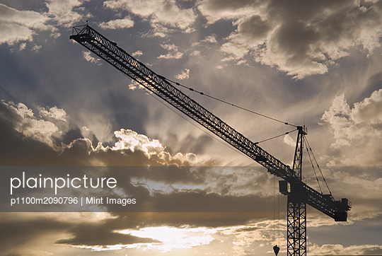 Tower Crane at Sunset - p1100m2090796 by Mint Images