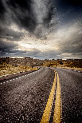 Road crossing Badlands National Park - p1154m1217543 by Tom Hogan