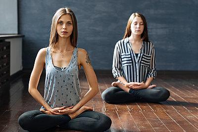 Women during yoga class - p1427m2110098 by Ivan Ozerov
