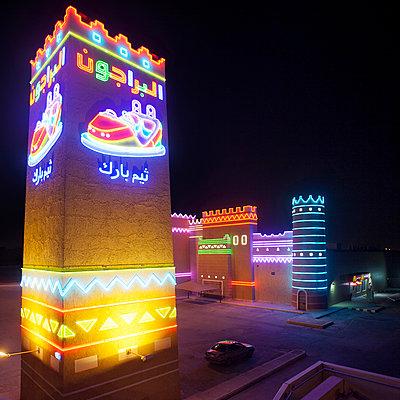 Illuminated theme park at night - p1542m2142383 by Roger Grasas