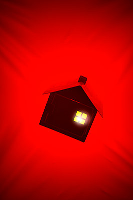 Illuminated model house against red background, collage - p975m2287892 by Hayden Verry