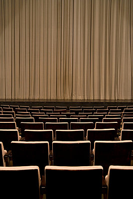 Closed curtain in an empty theater - p3016600f by Adam Burn