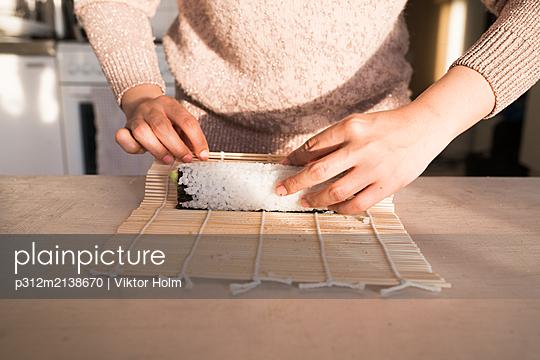 Woman preparing sushi - p312m2138670 by Viktor Holm