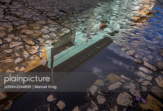 Cobblestone and a puddle, Cuba - p393m2244835 by Manuel Krug