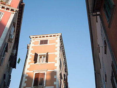 Houses in narrow street - p388m877283 by Andre