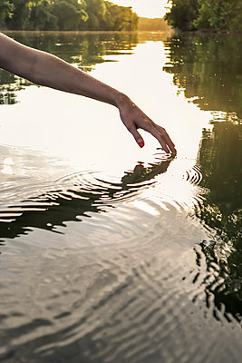Fingertips touching water surface - p1019m2100001 by Stephen Carroll
