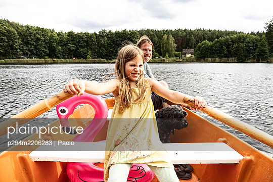 Father and daughter in a rowing boat - p294m2206283 by Paolo