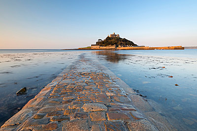 The stone causeway leading to St. Michaels Mount in early morning sunshine - p871m861624 by Adam Burton