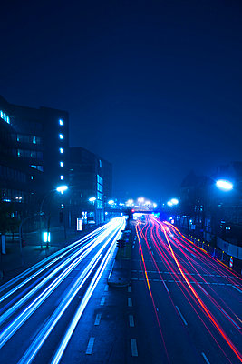 Street with light trails at night - p851m1048620 by Lohfink