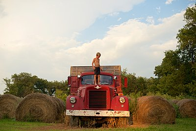 Boy on old Fire Truck - p1169m1124102 by Tytia Habing
