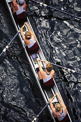 Overhead view of female crew racers rowing scull boat. - p1100m1220575 by Mint Images