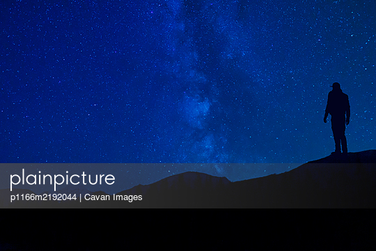 Star Gazing At Night Silhouette In Mountains - p1166m2192044 by Cavan Images