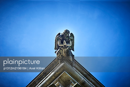 Angel on a roof of a church - p1312m2196184 by Axel Killian
