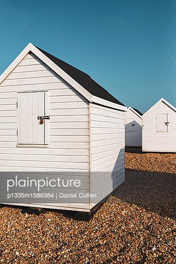 White Beach Hut on pebble beach - p1335m1586384 by Daniel Cullen