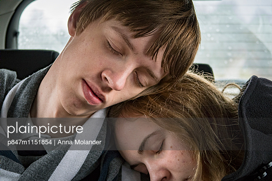 Young Couple Sleeping In Car   - p847m1151854 by Anna Molander