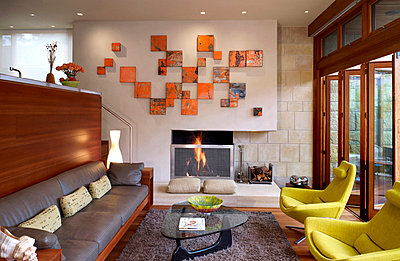 Split level living room with orange canvas art display in Odyssey House, Carmel, California, USA. - p855m713480 by John Edward Linden