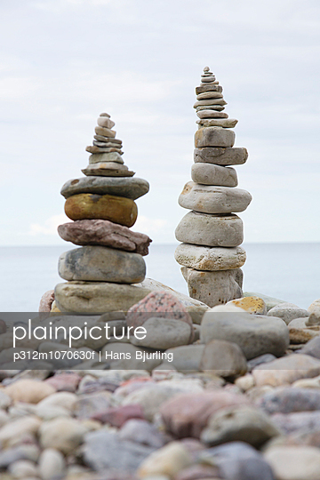 Stack of stones on beach - p312m1070630f by Hans Bjurling