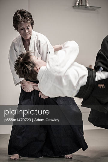 Caucasian people practicing martial arts - p555m1479723 by Adam Crowley