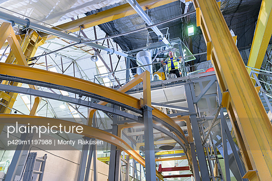 Robotic machinery in architectural stone factory, low angle view