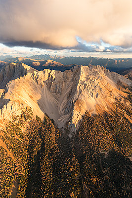 Aerial view of woods on the ridges of Latemar massif, Dolomites, South Tyrol, Italy, Europe - p871m1533921 by Roberto Moiola