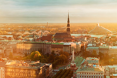 View of Riga from above late afternoon in autumn with the tower of St Peter's church - p1332m1539764 by Tamboly